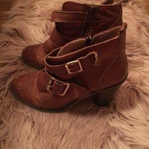 Brown booties by Steve Madden .